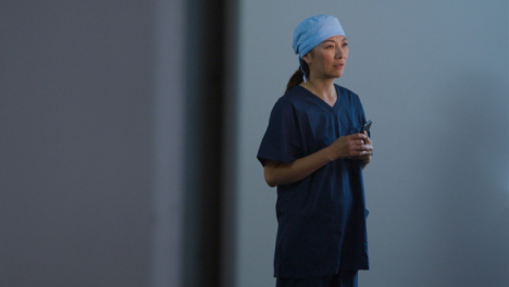 Worried-Middle-Aged-Surgeon-Finishing-a-Phone-Call