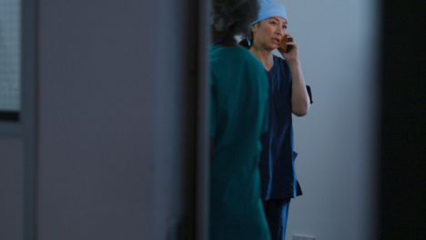 Worried-Middle-Aged-Surgeon-Finishing-Mobile-Phone-Conversation