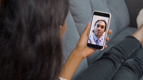 Young-Woman-Having-Video-Call-with-Doctor