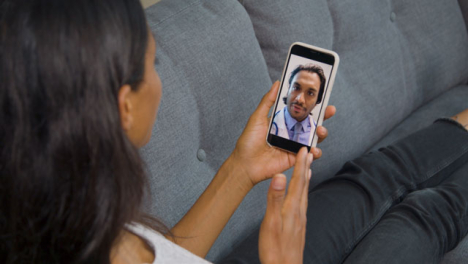 Young-Woman-Having-Video-Call-with-a-Doctor