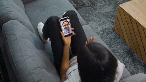 Young-Woman-On-Video-Call-with-Doctor