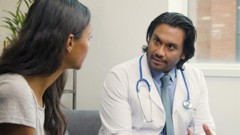 Doctor-Explaining-Difficult-Situation-to-Young-Woman