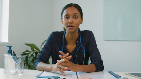 Young-Female-Doctor-Having-Conversation-On-Webcam