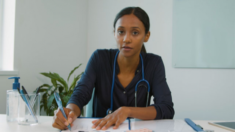 Young-Female-Doctor-Listening-During-Webcam-Chat