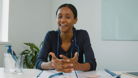 Young-Female-Doctor-Receives-Good-News-During-Video-Call