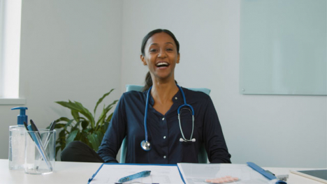Young-Female-Doctor-Receives-Good-News-During-Video-Meeting