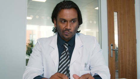 Young-Male-Doctor-Receives-Concerning-News-During-Video-Call