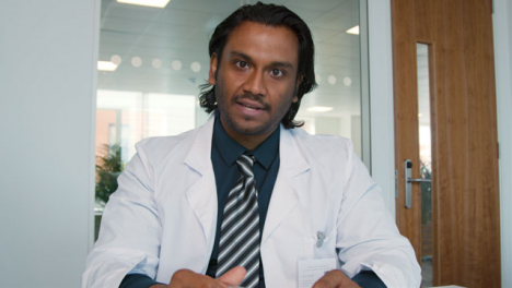 Young-Male-Doctor-Delivering-Concerning-News-During-Video-Call