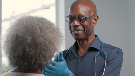 Positive-Middle-Aged-Doctor-Performing-Medical-Check-Up-