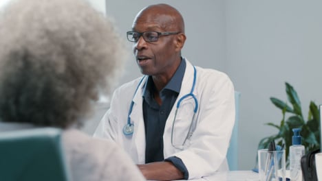 Approachable-Middle-Aged-Doctor-Talks-with-Patient