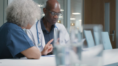 Two-Doctors-Having-Meeting-In-Office-Space
