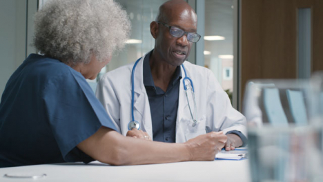 Two-Doctors-Having-a-Meeting-In-Office-Space