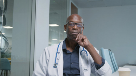 Middle-Aged-Doctor-Listening-During-Video-Meeting