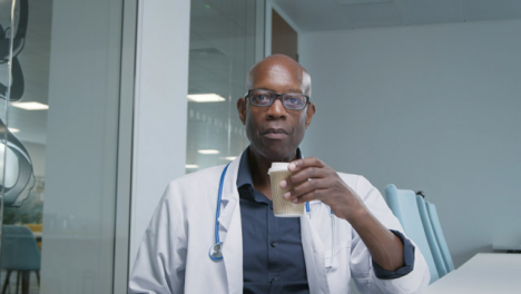 Middle-Aged-Doctor-Listening-During-Video-Call-Meeting