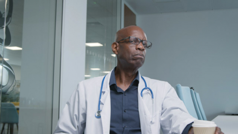 Middle-Aged-Doctor-Listening-During-a-Video-Meeting