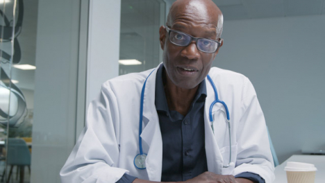 Middle-Aged-Doctor-Talking-to-Webcam-During-a-Video-Call