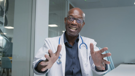 Middle-Aged-Doctor-Receives-Good-News-During-Video-Call