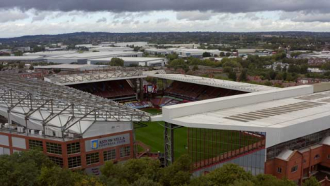 Rising-Drone-Shot-Behind-Trees-of-Villa-Park-Stadium
