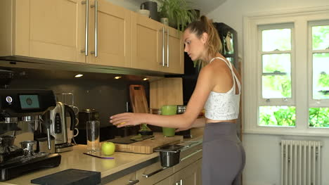 Young-Woman-Removing-Lid-From-Blender-Cup