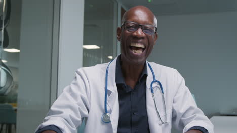 Middle-Aged-Male-Doctor-Receives-Good-News-on-Video-Call