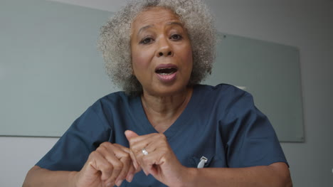 Middle-Aged-Female-Doctor-Talking-During-Video-Call