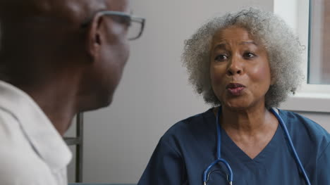Middle-Aged-Doctor-Talking-to-Male-Patient