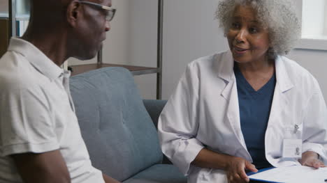 Female-Doctor-Giving-Good-News-to-Middle-Aged-Man