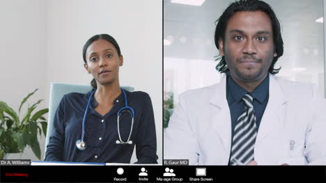 Two-Young-Doctors-Having-Video-Conference-Call