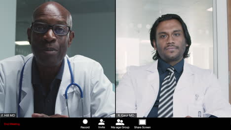 Middle-Aged-and-Young-Male-Doctors-Having-Video-Meeting
