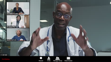 Middle-Aged-Male-Doctor-Gives-Good-News-During-Video-Conference