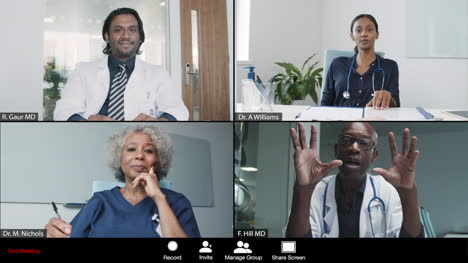 Middle-Aged-Male-Doctor-Leading-Video-Conference-with-Colleagues