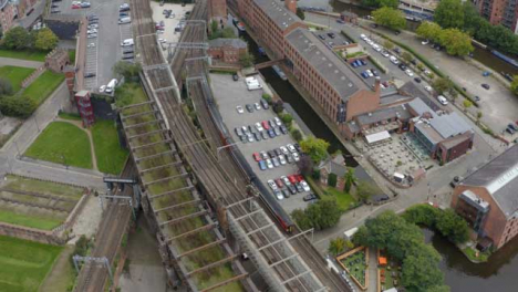 Drone-Shot-Tracking-Train-Travelling-Through-Castlefield-Canals-01