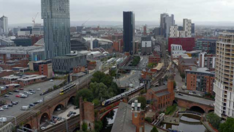 Drone-Shot-Tracking-Train-Travelling-Through-Castlefield-Canals-02