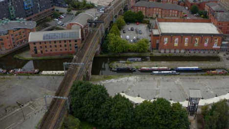 Drone-Shot-Approaching-Boats-At-Castlefield-Canals