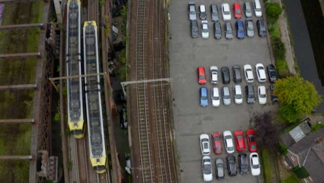 Drone-Shot-Tracking-Train-Travelling-Through-Castlefield-Canals-05