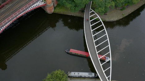 Overhead-Drone-Shot-Orbiting-Boat-At-Castlefield-Canals-01