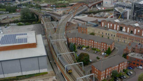 Drone-Shot-Tracking-Train-Travelling-Through-Castlefield-Canals-06
