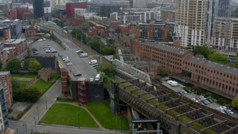 Drone-Shot-Tracking-Train-Travelling-Through-Castlefield-Canals-07