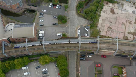 Overhead-Drone-Shot-Tracking-Train-Travelling-Through-Castlefield-Canals-01
