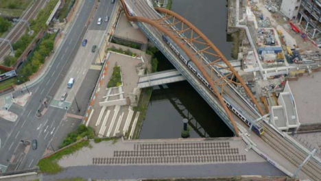 Overhead-Drone-Shot-Tracking-Train-Travelling-Through-Castlefield-Canals-02