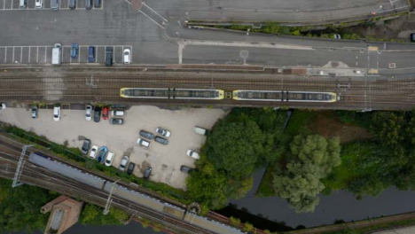Overhead-Drone-Shot-Tracking-Train-Travelling-Through-Castlefield-Canals-03