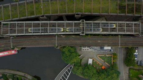 Overhead-Drone-Shot-Tracking-Train-Travelling-Through-Castlefield-Canals-04