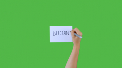 Woman-Writing-Bitcoin-on-Paper-with-Green-Screen