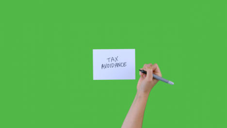 Woman-Writing-Tax-Avoidance-on-Paper-with-Green-Screen-03
