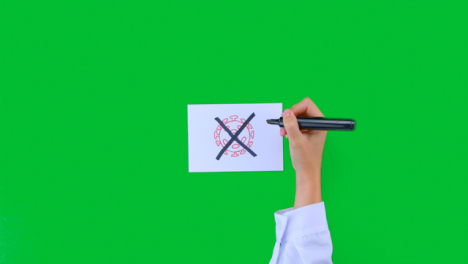 Doctor-Drawing-an-X-Over-Pathogen-Illustration-on-Paper-with-Green-Screen