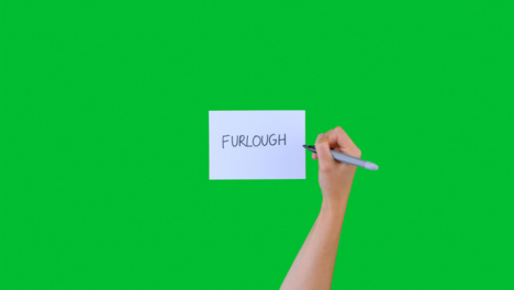 Woman-Writing-Furlough-on-Paper-with-Green-Screen
