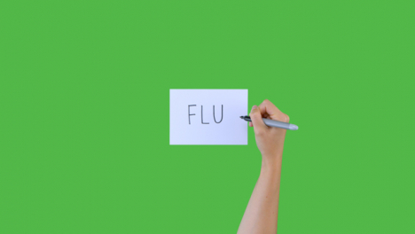 Woman-Writing-Flu-on-Paper-with-Green-Screen