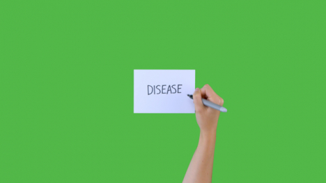 Woman-Writing-Disease-on-Paper-with-Green-Screen