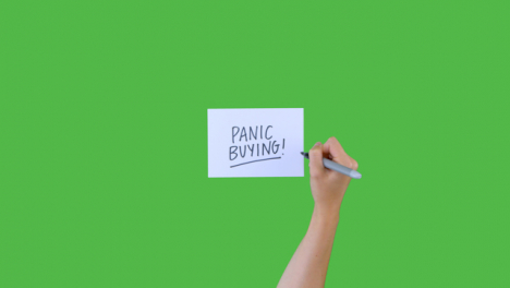 Woman-Writing-Panic-Buying-on-Paper-with-Green-Screen