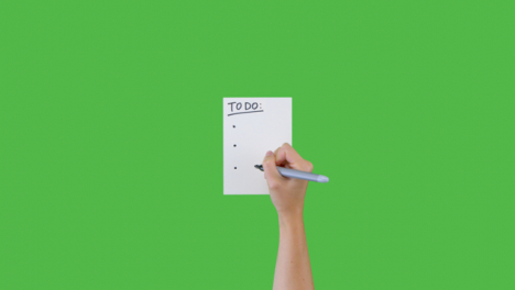 Woman-Writing-To-Do-and-Bullet-Points-on-Paper-with-Green-Screen